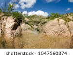 desert creeks  mexico. | Shutterstock . vector #1047560374