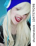 young blonde and beautiful... | Shutterstock . vector #1047579298