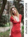 portrait of a blonde woman... | Shutterstock . vector #1047585358