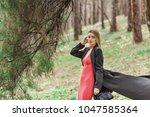 portrait of a blonde woman... | Shutterstock . vector #1047585364