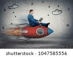 amazed young businessman flying ... | Shutterstock . vector #1047585556