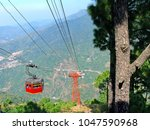 cable car ferrying tourists at...   Shutterstock . vector #1047590968