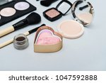 different makeup brushes and... | Shutterstock . vector #1047592888