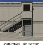 wooden rear stairs and covered... | Shutterstock . vector #1047594904