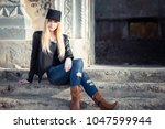 beautiful blonde is sitting on... | Shutterstock . vector #1047599944
