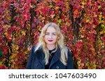 nice young blond is standing... | Shutterstock . vector #1047603490