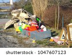 bulky waste on the street is... | Shutterstock . vector #1047607123