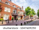 traditional old street and... | Shutterstock . vector #1047609250