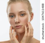 beautiful face and hands woman  ... | Shutterstock . vector #1047611488