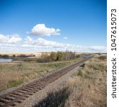 view of the railway track on a... | Shutterstock . vector #1047615073