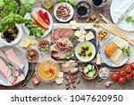 mediterranean appetizers table... | Shutterstock . vector #1047620950