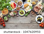 mediterranean appetizers table... | Shutterstock . vector #1047620953