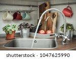 interior of a modern domestic... | Shutterstock . vector #1047625990