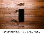 top view of a modern smartphone ... | Shutterstock . vector #1047627559
