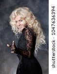 luxurious blonde with a fluffy... | Shutterstock . vector #1047636394