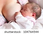 Mother breast feeding her infant - newborn baby girl. - stock photo