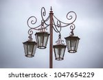 street lamppost with four lamps ... | Shutterstock . vector #1047654229