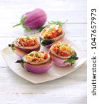 lentil stuffed eggplants.   Shutterstock . vector #1047657973