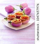 lentil stuffed eggplants. | Shutterstock . vector #1047657976