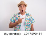 young shocked man pointing... | Shutterstock . vector #1047690454
