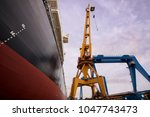 working field of a shipyard. | Shutterstock . vector #1047743473