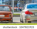 rear view of two cars of... | Shutterstock . vector #1047821923