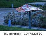 sunshade made from traffic... | Shutterstock . vector #1047823510