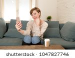 young attractive and happy red...   Shutterstock . vector #1047827746