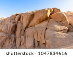 nature around ancient ruins... | Shutterstock . vector #1047834616