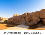 nature around ancient ruins... | Shutterstock . vector #1047836653