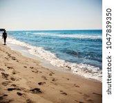 Small photo of Beach sand on the girl - Patara, Antalya, Turkey