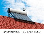 solar water heater on roof top  ... | Shutterstock . vector #1047844150