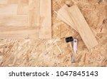 wooden floor installation   Shutterstock . vector #1047845143