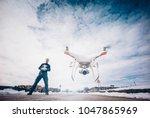 Man Flying Drone In Snowy...
