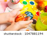 colorful easter painted egg in...   Shutterstock . vector #1047881194