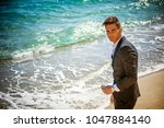 young handsome man in classical ... | Shutterstock . vector #1047884140