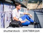 one handsome young man in urban ... | Shutterstock . vector #1047884164