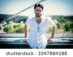 one handsome young man in urban ... | Shutterstock . vector #1047884188