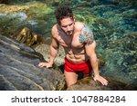 handsome  hot young bodybuilder ... | Shutterstock . vector #1047884284