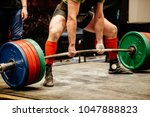 powerlifter exercise deadlift ... | Shutterstock . vector #1047888823