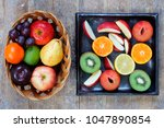 whole and sliced fruits of... | Shutterstock . vector #1047890854