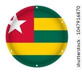 round metallic flag of togo... | Shutterstock .eps vector #1047916870