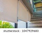 white curtains or roller blind...   Shutterstock . vector #1047929683