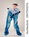 caucasian boy wearing his dad's ... | Shutterstock . vector #1047933376