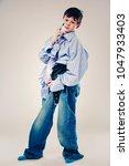 caucasian boy wearing his dad's ... | Shutterstock . vector #1047933403