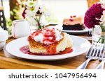 cheese cake topping strawberry...   Shutterstock . vector #1047956494