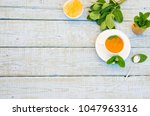 mint tea in white mug. herbal... | Shutterstock . vector #1047963316