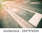 bicycle sign on street | Shutterstock . vector #1047976534