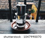 vietnamese coffee in hoi an ... | Shutterstock . vector #1047990070