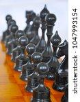 chessmen on the board   Shutterstock . vector #1047993154
